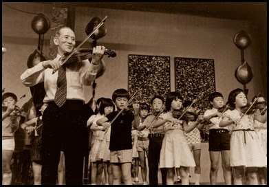Shinichi Suzuki with a group of young Japanese violinists